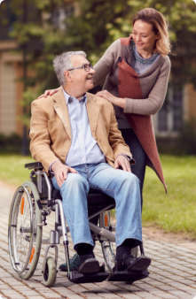 caregiver and patient in a wheelchair looking at each other
